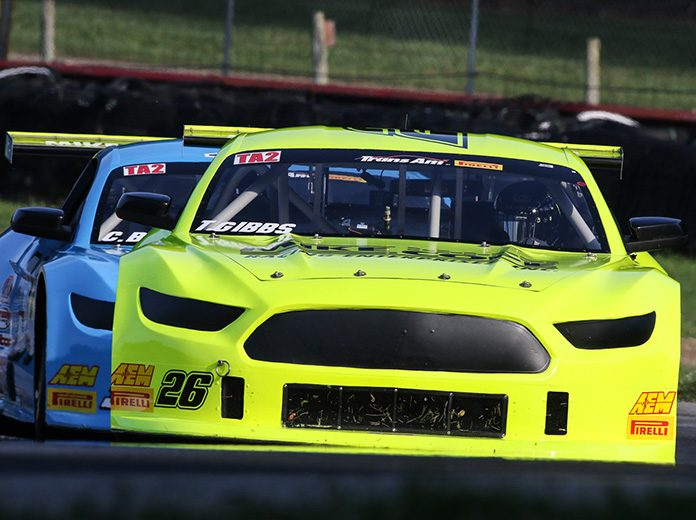 Ty Gibbs (26) races ahead of Christopher Bell in Trans-Am Series competition.