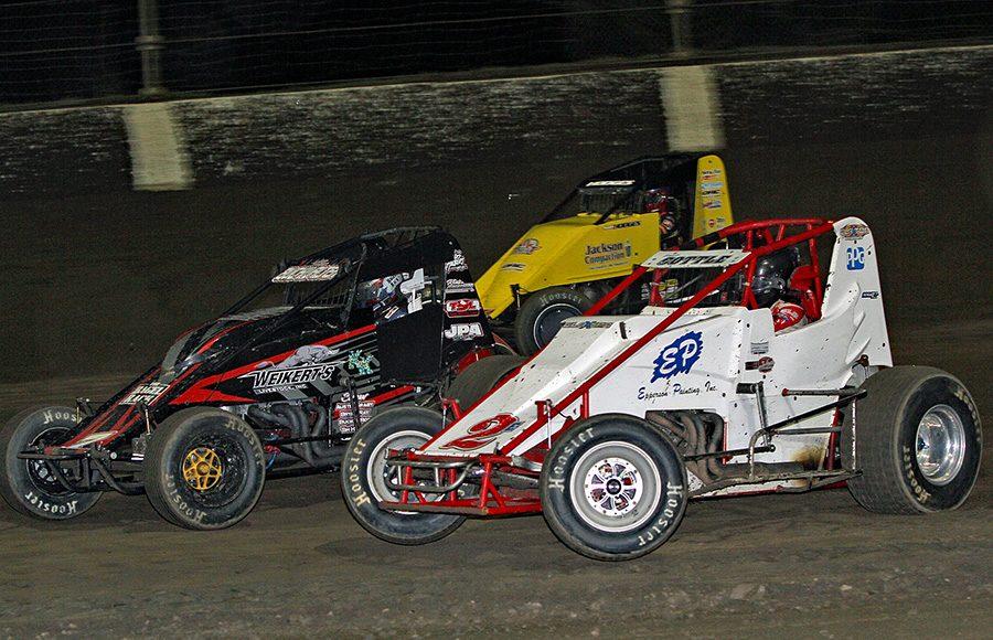 Shane Cottle (2E), Tim Buckwalter (7) and Josh Hodges battle three-wide during Friday's USAC AMSOIL National Sprint Car Series feature at Kokomo Speedway. (Jim Denhamer Photo)