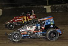 Justin Grant (4) battles under Kevin Thomas Jr. during Friday's USAC AMSOIL National Sprint Car Series feature at Kokomo Speedway. (Jim Denhamer Photo)
