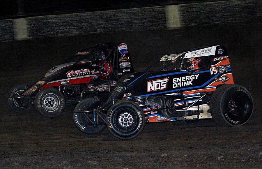 Chris Windom (5) races alongside Kyle Cummins during Friday's USAC AMSOIL National Sprint Car Series feature at Kokomo Speedway. (Jim Denhamer Photo)