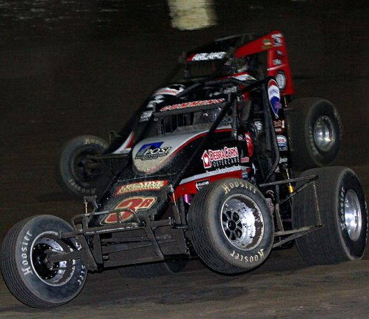 Kyle Cummins (3r) pops a wheel off the ground as he battles Dave Darland during Friday's USAC AMSOIL National Sprint Car Series feature at Kokomo Speedway. (Jim Denhamer Photo)