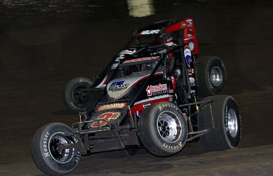 Kyle Cummins (3r) pops a wheel off the ground as he battles Dave Darland during Friday's USAC AMSOIL National Sprint Car Series feature at Kokomo Speedway. (Jim Denhamer Photo)
