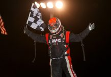 Jake Neuman celebrates after winning Friday's midget feature at Jacksonville Speedway. (Brendon Bauman Photo)