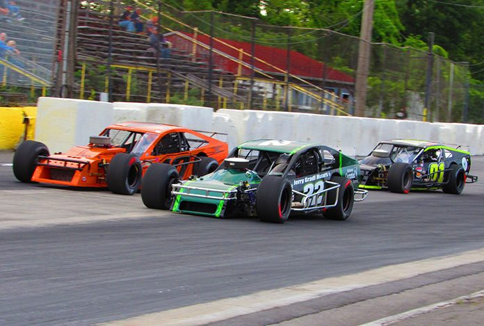 Chuck Hossfeld (22) races Daryl Lewis Jr. (10) and John Barber Saturday at Lancaster Speedway. (Craig Duve Photo)