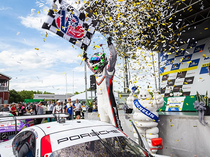 Nick Tandy celebrates after winning the GT Le Mans portion of the Michelin GT Challenge with co-driver Patrick Pilet Sunday at Virginia Int'l Raceway. (Sarah Weeks Photo)