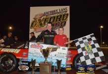 Travis Benjamin shares victory lane with his son after winning the Oxford 250 for the third time on Sunday night. (Ken MacIsaac Photo)