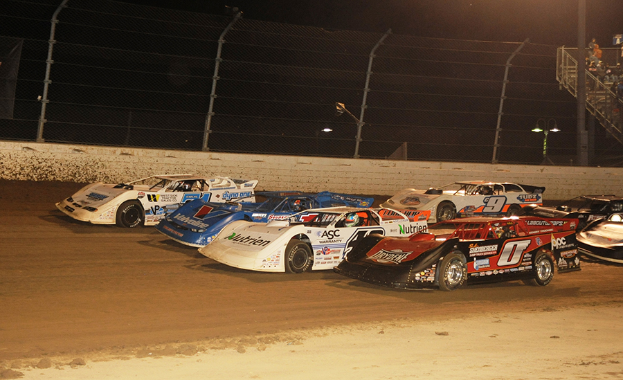 Drivers salute the fans by going four-wide prior to Saturday's Dirt Million finale at Mansfield Motor Speedway. (Julia Johnson Photo)