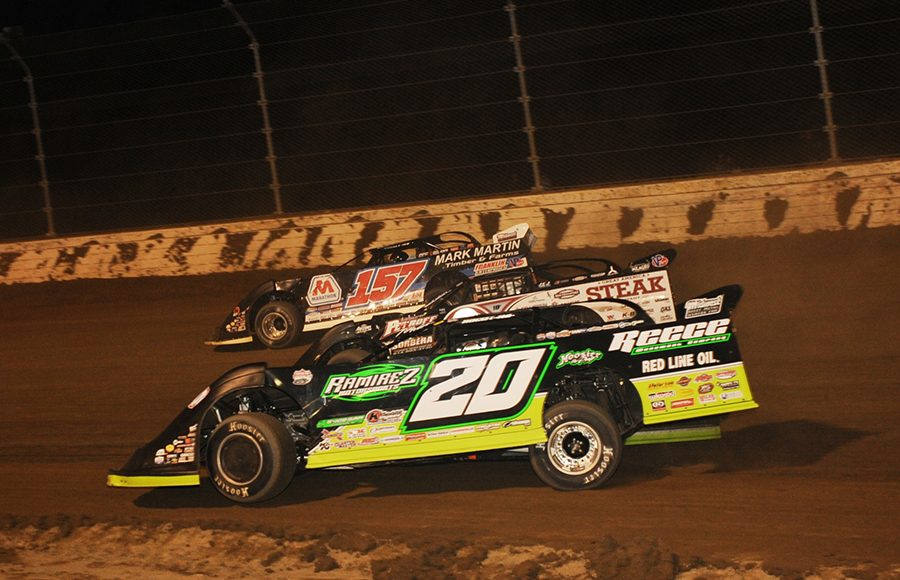 Jimmy Owens (20), Scott Bloomquist (0) and Mike Marlar race three-wide during Saturday's Dirt Million feature at Mansfield Motor Speedway. (Trent Gower Photo)