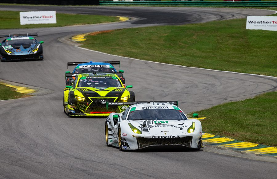 The No. 63 Ferrari 488 GT3 of Cooper MacNeil and Toni Vilander lead a group of cars during Sunday's Michelin GT Challenge at Virginia Int'l Raceway. (Sarah Weeks Photo)