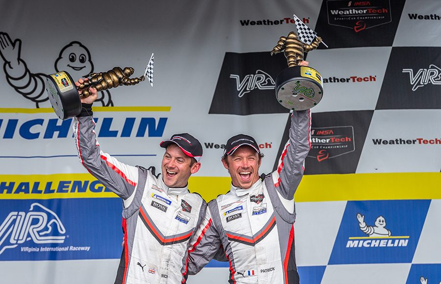 Nick Tandy (left) and Patrick Pilet celebrate after winning the GT Le Mans portion of the Michelin GT Challenge at Virginia Int'l Raceway. (Sarah Weeks Photo)