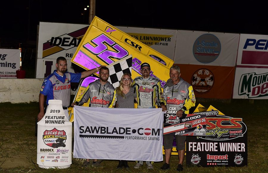 Blake Hahn poses in victory lane after winning Friday's Lucas Oil American Sprint Car Series feature at 34 Raceway. (Mark Funderburk Photo)