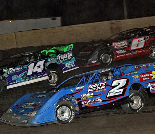 Travis Stemler (2), Brandon Thirlby (14) and Dona Marcoullier race for position during Friday's American Ethanol Late Model Tour event at Farmer City Raceway. (Jim Denhamer Photo)