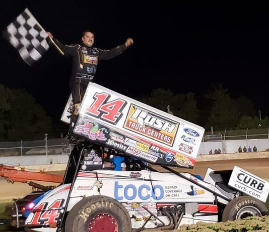 Tony Stewart in victory lane Saturday at the Plymouth Dirt Track. (Dave Olson Photo)