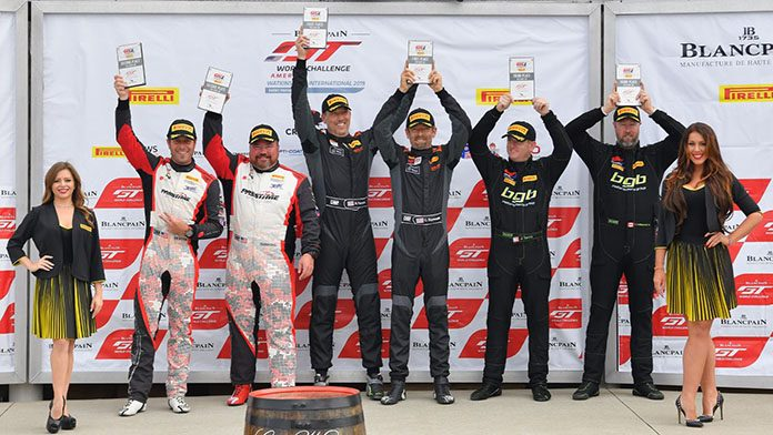Christian Szymczak and Matthew Fassnacht (center) won Sunday's Pirelli GT4 America SprintX event at Watkins Glen Int'l.