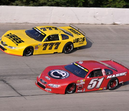 Stephen Nasse (51) passes Cody Coughlin en route to victory Sunday at Winchester Speedway. (Randy Crist Photo)
