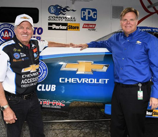 John Force (left) poses with Chevrolet's Vice President, Performance and Motorsports, Jim Campbell.