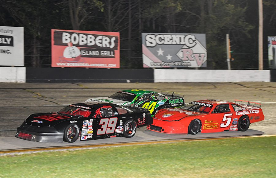 Andrew Morrissey (39) races ahead of Justin Mondeik (44) and Casey Johnson during Saturday's ARCA Midwest Tour event at Dells Raceway Park. (Doug Hornickel Photo)