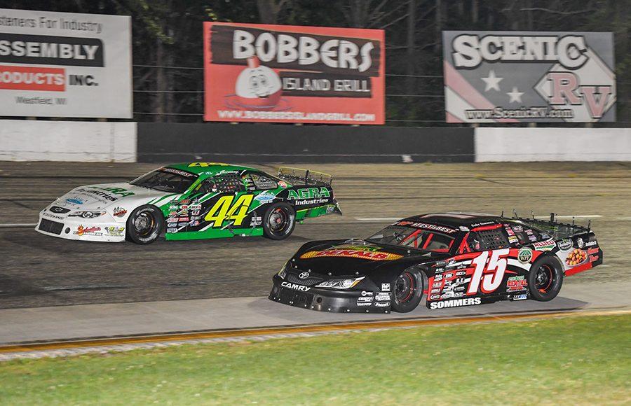 Gabe Sommers (15) races under Justin Mondeik during Saturday's ARCA Midwest Tour event at Dells Raceway Park. (Doug Hornickel Photo)