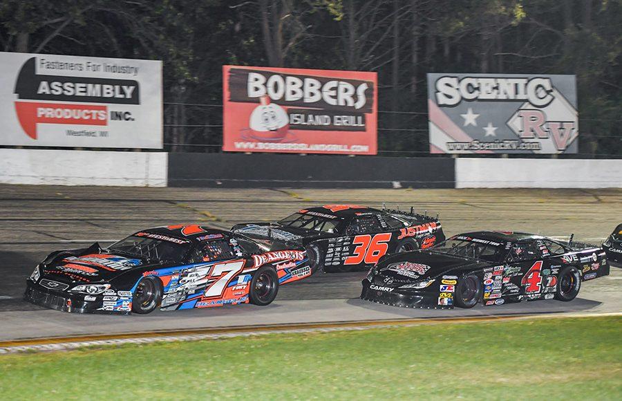 John DeAngelis Jr. (7) races ahead of Dan Fredrickson (36) and Luke Fenhaus during Saturday's ARCA Midwest Tour event at Dells Raceway Park. (Doug Hornickel Photo)