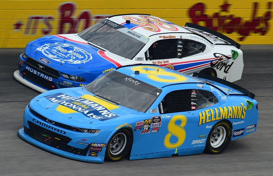Dale Earnhardt Jr. (8) battles Chase Briscoe during Saturday's NASCAR Xfinity Series race at Darlington Raceway. (NASCAR Photo)