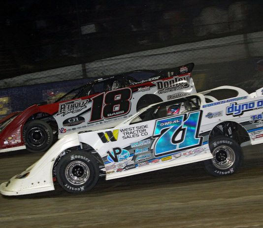 Hudson O'Neal (71) races under Shanon Babb at Eldora Speedway. (Jim DenHamer photo)