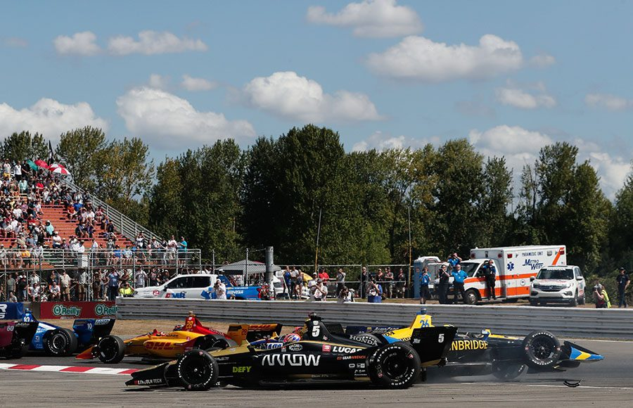 James Hinchcliffe and Zach Veach make contact in an opening lap crash during the Grand Prix of Portland. (IndyCar Photo)