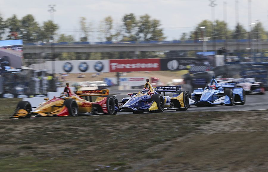 Ryan Hunter-Reay (28) races ahead of Alexander Rossi during Sunday's Grand Prix of Portland. (IndyCar Photo)
