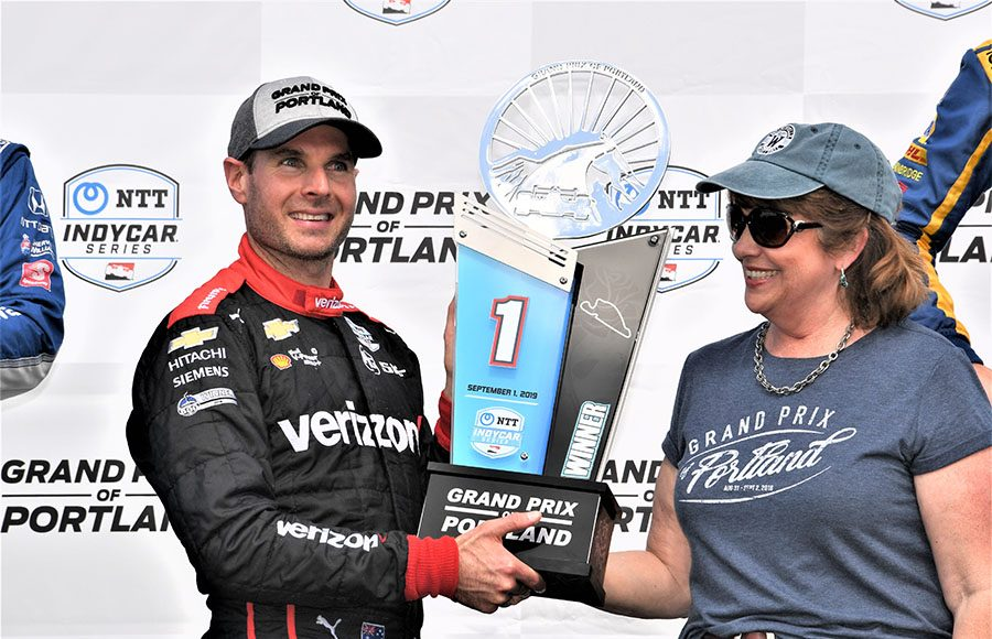Will Power accepts the winner's trophy after winning Sunday's Grand Prix of Portland. (Al Steinberg Photo)