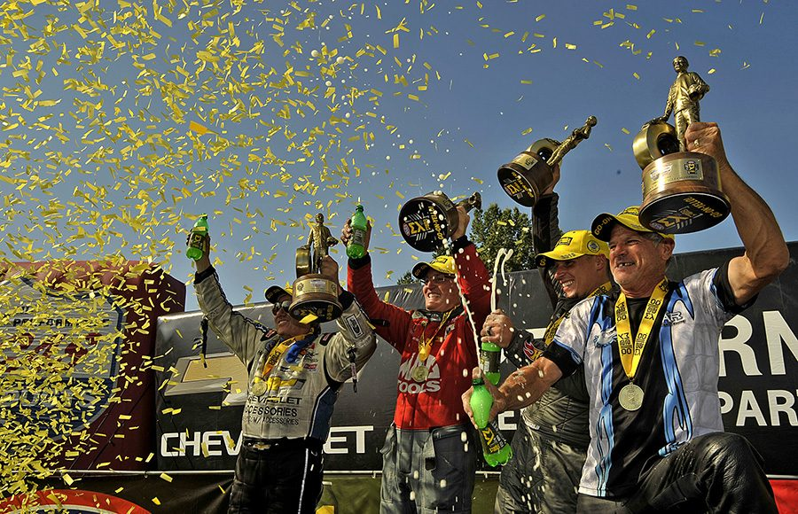 (From left) John Force, Doug Kalitta, Alex Laughlin and Jerry Savoie celebrate after earning victories Monday during the Chevrolet Performance U.S. Nationals. (Shawn Crose Photo)