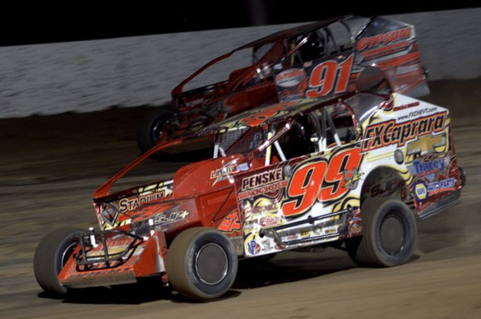 Larry Wight (99) races under Billy Decker at Autodrome Granby. (Dave Dalesandro photo)
