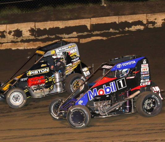 Logan Seavey (67) races under Ethan Mitchell at Jacksonville (Ill.) Speedway. (Brendon Bauman photo)