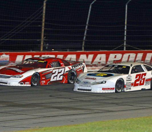 Bubba Pollard (26) drives by Casey Roderick (22) Saturday at Lucas Oil Raceway. (Todd Ridgeway photo)