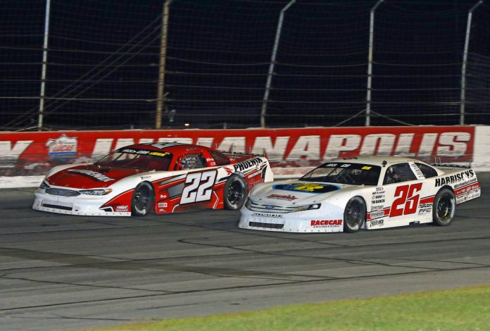 Bubba Pollard (26) drives by Casey Roderick (22) Saturday at Lucas Oil Raceway. (Todd Ridgeway photo)