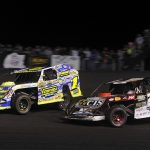 Ethan Dotson (1) battles Ricky Thornton Jr. during the IMCA Super Nationals modified feature Saturday at Boone Speedway. (Shawn Crose Photo)
