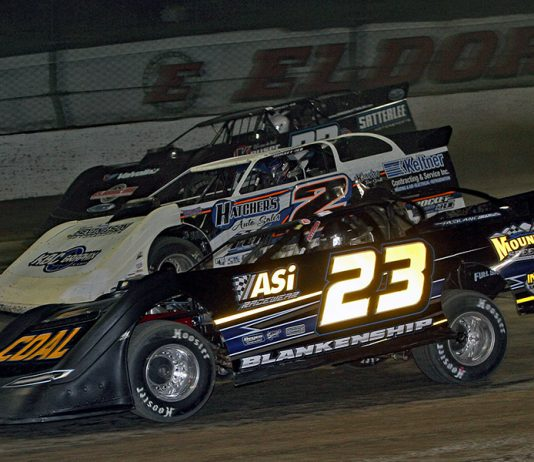 John Blankenship (23), Nick Hoffman (2) and Gregg Satterlee battle for position during World 100 preliminary action Thursday at Eldora Speedway. (Jim Denhamer Photo)
