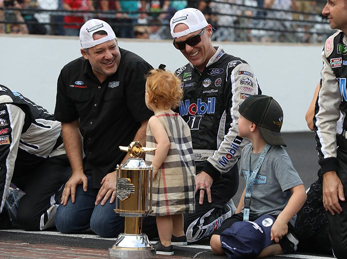 Tony Stewart (left) enjoys the spoils of victory after Sunday's Big Machine Vodka 400 at Indianapolis Motor Speedway. (IMS Photo)
