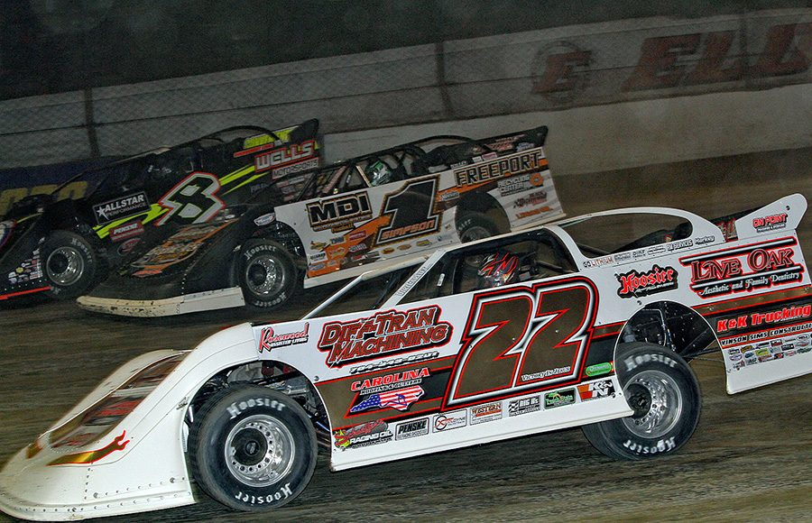 Chris Ferguson (22), Chad Simpson (1) and Kyle Strickler battle for position during Friday's World 100 preliminary event at Eldora Speedway. (Julia Johnson Photo)