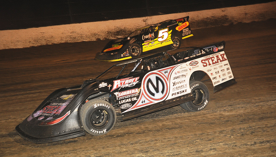Chris Madden (0M) battles Don O'Neal during Friday's World 100 preliminary event at Eldora Speedway. (Julia Johnson Photo)