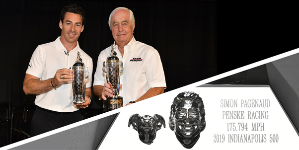 Simon Pagenaud and Roger Penske were presented with their Baby Borg trophies on Monday, with Pagenaud's trophy also featuring a likeness of his dog, Norman.