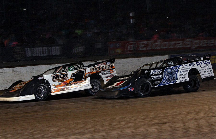 Chad Simpson (1) battles Scott Bloomquist during Saturday's World 100 finale at Eldora Speedway. (Jim Denhamer Photo)