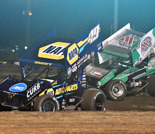 Brad Sweet (49) races ahead of Kraig Kinser during the Gold Cup Race of Champions Saturday at Silver Dollar Speedway. (Tom Parker Photo)