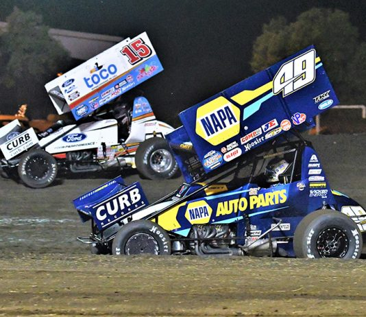 Brad Sweet (49) battles Donny Schatz during the Gold Cup Race of Champions Saturday at Silver Dollar Speedway. (Tom Parker Photo)