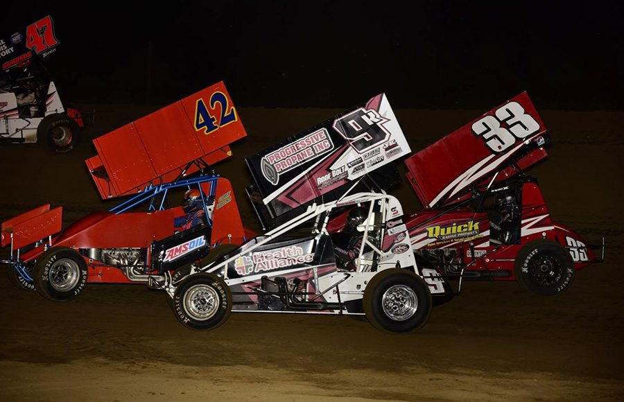 Cory Bruns (42), Kyle Schuett (9k) and Andy Bishop race for position during Saturday's Built Ford Tough MOWA Sprint Car Series feature at Spoon River Speedway. (Mark Funderburk Photo)