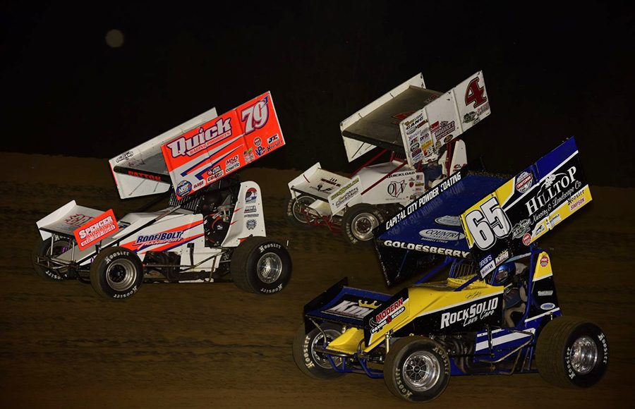 Jacob Patton (49) leads Danny Smith (4) and Jordan Goldesberry during Saturday's Built Ford Tough MOWA Sprint Car Series feature at Spoon River Speedway. (Mark Funderburk Photo)