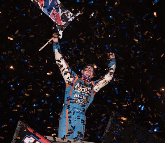 Shane Golobic celebrates victory at Placerville Speedway. (Devin Mayo photo)