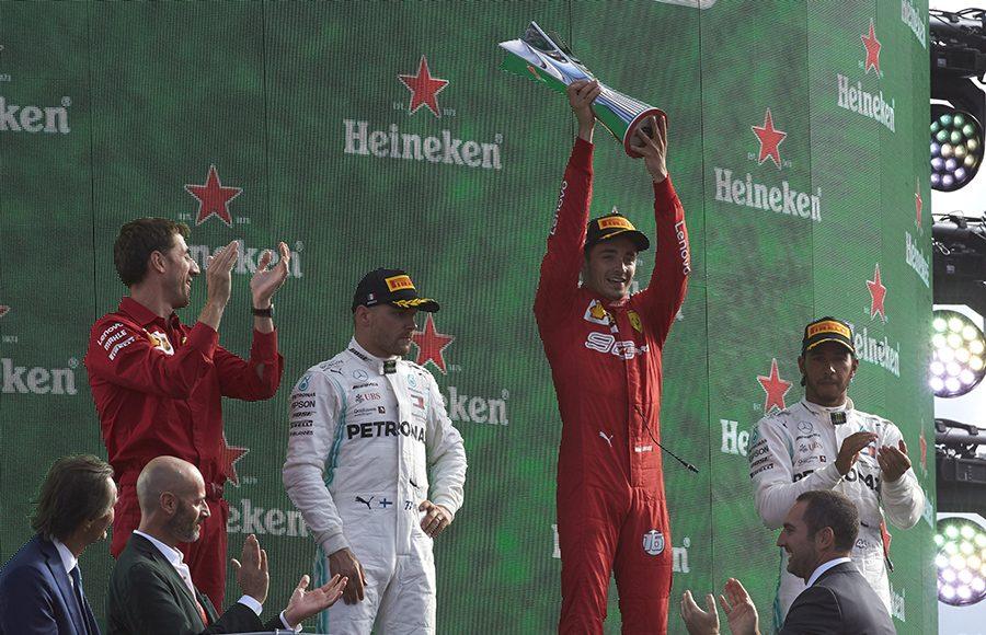 Charles Leclerc (center) celebrates after winning Sunday's Italian Grand Prix. (Steve Etherington Photo)