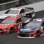 William Byron (24), Daniel Suarez (41) and David Ragan race three-wide during Sunday's Big Machine Vodka 400 at Indianapolis Motor Speedway. (HHP/Harold Hinson Photo)