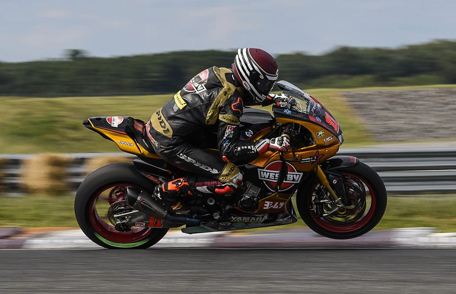 Mathew Scholtz pops a wheelie during Sunday's MotoAmerica Superbike race at New Jersey Motorsports Park. (Dennis Bicksler Photo)