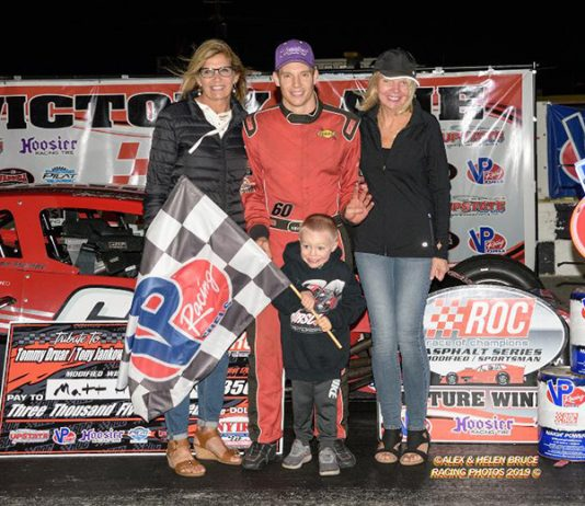 Matt Hirschman and his son Matty celebrate his fourth win in the Tommy Druar/Tony Jankowiak Memorial 110 Friday night. (Alex & Helen Bruce Photo)