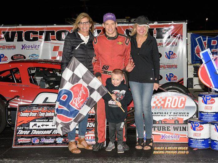 Matt Hirschman and his son Matty celebrate his fourth win in the Tommy Druar/Tony Jankowiak Memorial 110 Friday night. (Alex & Helen Bruce Photo)